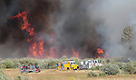 Firefighters fight a 30-acre brush fire in Washoe Valley on Thursday, Aug. 23, 2012. No structures were threatened and crews from Carson City, Truckee Meadows Fire and NDF are on scene. Rush hour traffic was backed up for about two miles for northbound traffic..Photo by Cathleen Allison