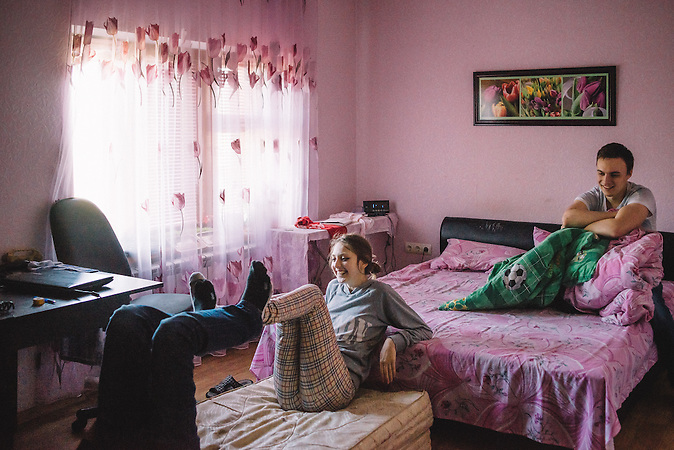 Katrine plays with her younger brother Nikita in their parents room. Ribnita, Transnistria