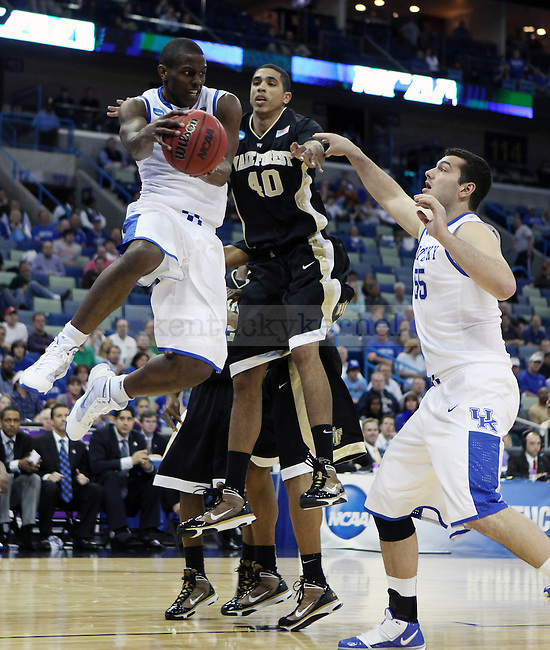 Sophomore guard Darius Miller tries to pass the ball to junior forward Josh Harrellson during the second half of UK's second round  win, 90-60 over Wake Forest in the NCAA tournament at New Orleans Arena on Saturday, March 20, 2010. Photo by Britney McIntosh | Staff