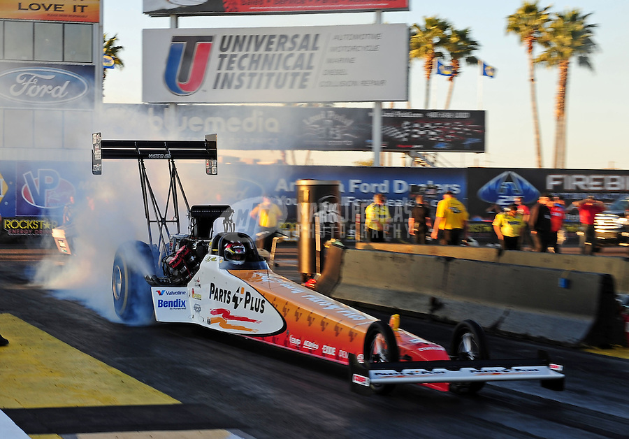 Feb. 17 2012; Chandler, AZ, USA; NHRA top fuel dragster driver Clay Millican during qualifying for the Arizona Nationals at Firebird International Raceway. Mandatory Credit: Mark J. Rebilas-