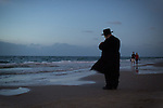 An Ultra-Orthodox Jewish man prays during a 'Tashlich' ritual along the Mediterranean Sea in Herzliya, central Israel. 'Tashlich' ('to cast away') is a Jewish practice by which believers go to a flowing body of water and symbolically 'throw away' their sins, before the Day of Atonement ('Yom Kippur'), the holiest day in the Jewish calendar.