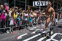 NEW YORK JUNE 25:  A naked man holds a sign during the annual New York Gay Pride Parade in Fifth Avenue on June 25, 2017 in New York. (Photo by Maite H. Mateo/VIEWpress/Corbis via Getty Images)