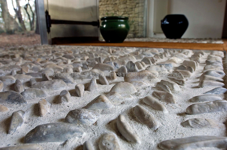 3/11/2006--Avignon, France..Stones embedded in the floor by an exterior door of designer Maria Pergay's summer home just outside Avignon in the south of France. Pergay was born in Moldavie, Russia in 1930 and emigrated to Paris in 1937. Over Pergay?s 50-plus-year career, her objects, furniture and decor have brought her a following that included Salvador Dali, Pierre Cardin and King Fahd of Saudi Arabia, but her work has only recently gained recognition among design collectors, curators and aficionados...Photograph By Stuart Isett.All photographs ©2006 Stuart Isett.All rights reserved.