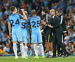 John Stones of Manchester City receives instructions from Josep Guardiola manager of Manchester City during the UEFA Champions League Group C match at The Etihad Stadium, Manchester. Picture date: September 14th, 2016. Pic Simon Bellis/Sportimage