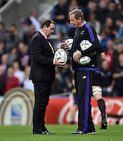 New Zealand Head Coach Steve Hansen inspects the matchday balls during the pre-match warm-up. Rugby World Cup Pool C match between New Zealand and Tonga on October 9, 2015 at St James' Park in Newcastle, England. Photo by: Patrick Khachfe / Onside Images