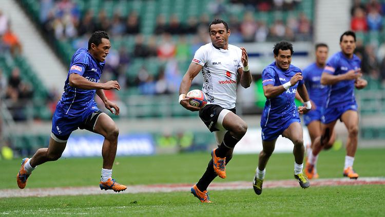 Donasio Ratubuli of Fiji accelerates clear during the Cup quarter final match against Samoa during Day Two of the iRB Marriott London Sevens at Twickenham on Sunday 11th May 2014 (Photo by Rob Munro)