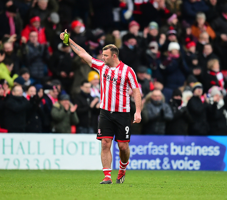 Lincoln City's Matt Rhead applauds the fans at the final whistle<br /> <br /> Photographer Andrew Vaughan/CameraSport<br /> <br /> The EFL Sky Bet League Two - Lincoln City v Grimsby Town - Saturday 19 January 2019 - Sincil Bank - Lincoln<br /> <br /> World Copyright &copy; 2019 CameraSport. All rights reserved. 43 Linden Ave. Countesthorpe. Leicester. England. LE8 5PG - Tel: +44 (0) 116 277 4147 - admin@camerasport.com - www.camerasport.com