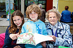 Anna and David Waldron with Anne O'Neill reading a book at K Fest Arts and Music festival in Killorglin on Sunday