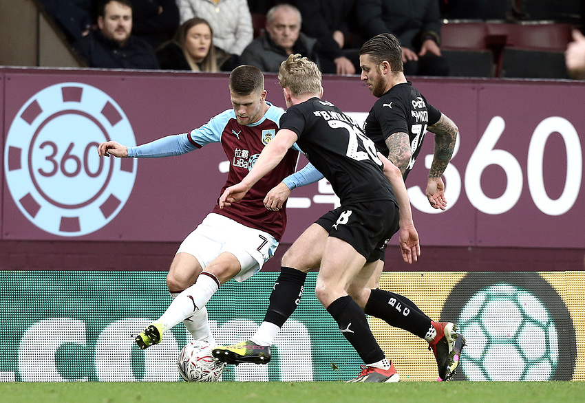 Burnley's Johann Gudmundsson battles with Barnsley's Ben Williams and George Moncur (right) <br /> <br /> Photographer Rich Linley/CameraSport<br /> <br /> Emirates FA Cup Third Round - Burnley v Barnsley - Saturday 5th January 2019 - Turf Moor - Burnley<br />  <br /> World Copyright © 2019 CameraSport. All rights reserved. 43 Linden Ave. Countesthorpe. Leicester. England. LE8 5PG - Tel: +44 (0) 116 277 4147 - admin@camerasport.com - www.camerasport.com