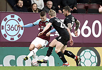 Burnley's Johann Gudmundsson battles with Barnsley's Ben Williams and George Moncur (right) <br /> <br /> Photographer Rich Linley/CameraSport<br /> <br /> Emirates FA Cup Third Round - Burnley v Barnsley - Saturday 5th January 2019 - Turf Moor - Burnley<br />  <br /> World Copyright &copy; 2019 CameraSport. All rights reserved. 43 Linden Ave. Countesthorpe. Leicester. England. LE8 5PG - Tel: +44 (0) 116 277 4147 - admin@camerasport.com - www.camerasport.com