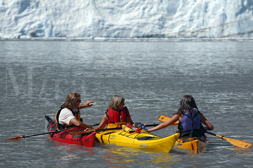 Kayaking in Harriman Fiord with Barry Glacier in background, Prince William Sound, Chugach National Forest, Alaska.