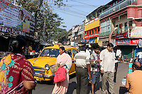 Pedestrians walk through the busy streets of central Kolkata.<br /> <br /> To license this image, please contact the National Geographic Creative Collection:<br /> <br /> Image ID: 1925750 <br />  <br /> Email: natgeocreative@ngs.org<br /> <br /> Telephone: 202 857 7537 / Toll Free 800 434 2244<br /> <br /> National Geographic Creative<br /> 1145 17th St NW, Washington DC 20036