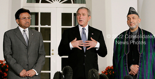 WASHINGTON - SEPTEMBER 27:  (AFP OUT) US President George W. Bush (M) deliver remarks while flanked by Afghanistan President Hamid Karzai (R) and Pakistani President Pervez Musharraf (L) in the Rose Garden at the White House September 27, 2006 in Washington. DC. Bush is hosting a meeting between the two leaders.  (Photo by Mark Wilson/Getty Images) *** Local Caption *** Hamid Karzai;George W. Bush;Pervez Musharraf