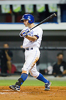 Ryan Stovall #9 of the Burlington Royals follows through on his swing against the Bristol White Sox at Burlington Athletic Stadium August 13, 2010, in Burlington, North Carolina.  Photo by Brian Westerholt / Four Seam Images