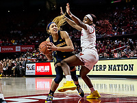 COLLEGE PARK, MD - DECEMBER 28: Kaila Charles #5 of Maryland blocks a shot by Kayla Robbins #5 of Michigan. during a game between University of Michigan and University of Maryland at Xfinity Center on December 28, 2019 in College Park, Maryland.