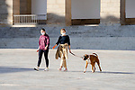 Two women walk with their dog during the first day of liftning of the confinement restrictions in Caceres, Extremadura. 02 May 2020(Alterphotos/Francis Gonzalez)