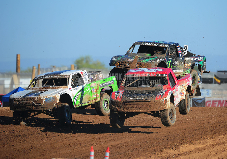 Apr 16, 2011; Surprise, AZ USA; LOORRS driver Rodrigo Ampudia (36) jumps alongside Jeff Geiser (44) and Jeremy Mcgrath (2) during round 3 at Speedworld Off Road Park. Mandatory Credit: Mark J. Rebilas-