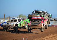 Apr 16, 2011; Surprise, AZ USA; LOORRS driver Rodrigo Ampudia (36) jumps alongside Jeff Geiser (44) and Jeremy Mcgrath (2) during round 3 at Speedworld Off Road Park. Mandatory Credit: Mark J. Rebilas-
