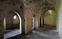 Inside a room with vaulted roof and arcade, in the Kalaja e Porto Palermos (Porto Palermo Castle or Panormos Castle), in the Porto Palermo Bay near Himare in the Albanian Riviera in Southern Albania. The castle was built in triangular plan by the Venetians and was ruled by Ali Pasha before he bequested it to the Royal Navy in 1803. Picture by Manuel Cohen