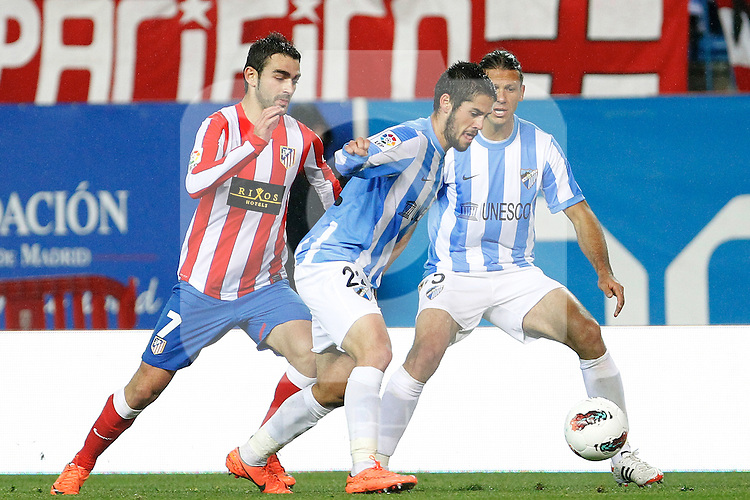Atletico de Madrid's Adrian Lopez (l) and Malaga's Francisco Alarcon Isco  (c) and Martin Demichelis during La Liga match. Mayo 5,2012. (ALTERPHOTOS/Arnedo & Alconada)