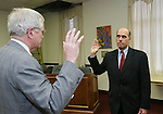 TORRINGTON, CT,  03 JANUARY 2006, 010307BZ01- Attorney Thomas F. Wall Jr., left,  administers the oath of office to Probate Judge Michael F. Magistrali in the council chambers at Torrington City Hall Wednesday afternoon.<br /> Jamison C. Bazinet Republican-American