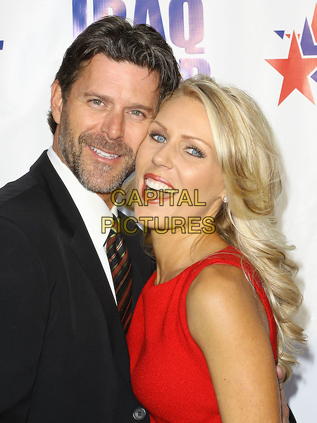 "SLADE SMILEY & GRETCHEN ROSSI.""A Night of Honour"" Hosted By Dr. Phil McGraw held At The Universal City Hilton Hotel, Universal City, California, USA..October 4th, 2009.half length black suit jacket red mouth open lipstick beard facial hair stubble .CAP/ADM/KB.©Kevan Brooks/AdMedia/Capital Pictures."