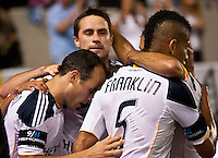 CARSON, CA – September 9, 2011: LA Galaxy players Landon Donovan (10), Todd Dunivant (2) and Sean Franklin (5) celebrating Landon Donovan's goal during the match between LA Galaxy and Colorado Rapids at the Home Depot Center in Carson, California. Final score LA Galaxy 1, Colorado Rapids 0.