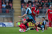 Blair Turgott of Leyton Orient attempts to stop Stephen McGinn of Wycombe Wanderers during the Sky Bet League 2 match between Leyton Orient and Wycombe Wanderers at the Matchroom Stadium, London, England on 19 September 2015. Photo by Andy Rowland.