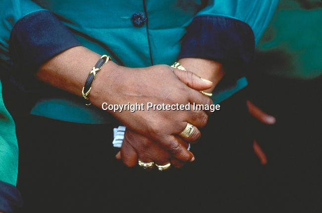 PEMANNW55017.Personality. Winnie Mandela. Johannesburg, South Africa. She campaigns in support of the ANC. Her hands folded, wearing gold rings. Jewellery. Nelson Mandelas ex-wife. .©Per-Anders Pettersson/iAfrika Photos