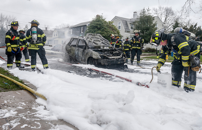 MANASQUAN, NJ — April 1, 2016 —Manasquan firefighters use foam to battle a car fire on Broad Street at about 9:40am Friday morning. The driver of the vehicle was not injured.  photo by Andrew Mills