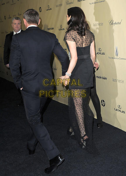 Rachel Weisz & Daniel Craig.The Weinstein Company's 2013 Golden Globe After Party held at The Old trader vic's at The Beverly Hilton Hotel in Beverly Hills, California, USA..January 13th, 2013  .full length black dress suit holding hands back behind rear married husband wife white blue polka dot  .CAP/DVS.©DVS/Capital Pictures.