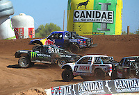 Apr 16, 2011; Surprise, AZ USA; LOORRS driver Rick Huseman (36) races alongside Ricky Johnson (48) and Carl Renezeder (17) during round 3 at Speedworld Off Road Park. Mandatory Credit: Mark J. Rebilas-.