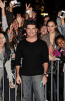 LOS ANGELES, CA - DECEMBER 06: Simon Cowell  arrives at the 'The X Factor' Viewing Party Sponsored By Sony X Headphones at Mixology101 & Planet Dailies on December 6, 2012 in Los Angeles, California.PAP1212JP346.PAP1212JP346.PAP1212JP346.