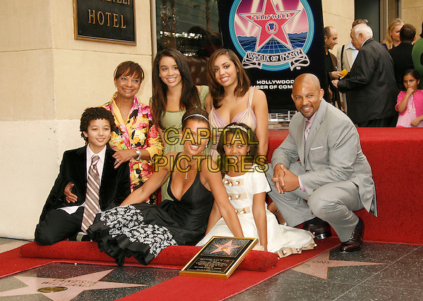 VANESSA L. WILLIAMS, DEVIN (SON) HELEN (MOTHER), JILLIAN, MELANIE & SASHA (DAUGHTERS) & CHRIS WILLIAMS (BROTHER).Vanessa Williams Celebrates Her Birthday With a Star On The Hollywood Walk of Fame, Holllywood, California, USA..March 19th, 2007 .full length black dress floral print kneeling grey gray suit mom mum siblings .CAP/ADM/RE.©Russ Elliot/AdMedia/Capital Pictures