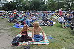 Revelers sit on the lawn at the Pitchfork Music Festival in Union Park in Chicago, Illinois on July 19, 2009.