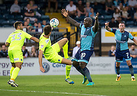 Adebayo Akinfenwa of Wycombe Wanderers appeals for handball by Luke Prosser of Colchester United during the Sky Bet League 2 match between Wycombe Wanderers and Colchester United at Adams Park, High Wycombe, England on 27 August 2016. Photo by Liam McAvoy.