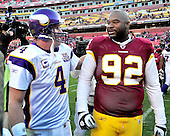 Minnesota Vikings quarterback Brett Favre (4) exchanges pleasantries  with Washington Redskins defensive lineman Albert Haynesworth (92) as they leave the field following the game at FedEx Field in Landover, Maryland on Sunday, November 28, 2010.  The Vikings won the game 17 - 13..Credit: Ron Sachs / CNP