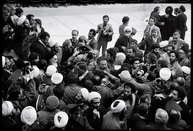 Ayatollah Khomeini is surrounded by supporters and the media at the airport. Tehran, February 1, 1979