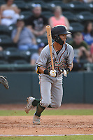 Greensboro Grasshoppers Ji-Hwan Bae (51) takes off for first base during a game with the Hickory Crawdads at L.P. Frans Stadium on May 27, 2019 in Hickory, North Carolina.  The Grasshoppers defeated the Crawdads 8-2. (Tracy Proffitt/Four Seam Images)