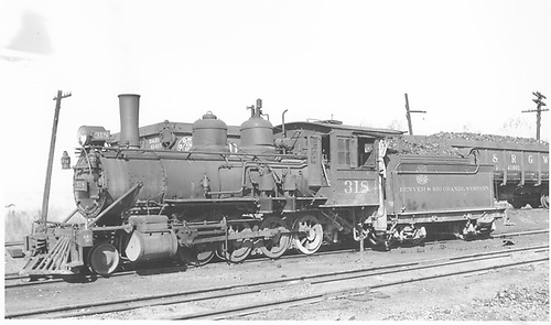 3/4 fireman's-side view of D&amp;RGW #318 at Montrose.<br /> D&amp;RGW  Montrose, CO  Taken by Brown, Lawrie - 4/13/1937