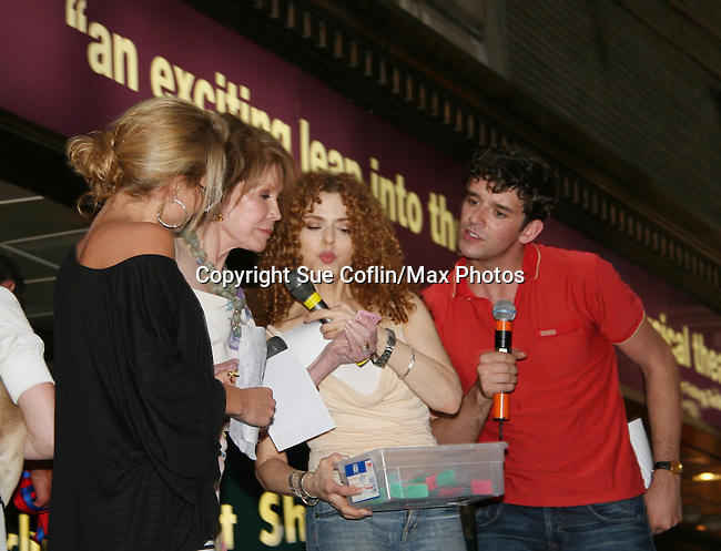 """Ugly Betty's Michael Urie and Becky Newton on stage with host Bernadette Peters at Broadway Barks 11 - a """"Pawpular"""" star-studded dog and cat adopt-a-thon on July 11, 2009 in Shubert Alley, New York City, NY. (Photo by Sue Coflin/Max Photos)"""