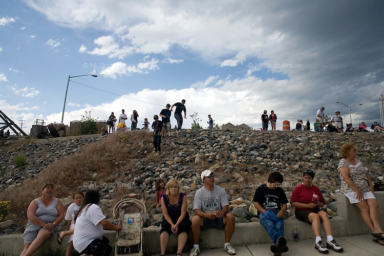 Crowds gather on a hillside to watch a motorcycle performance during Evel Knievel Days in Butte, Montana, USA.