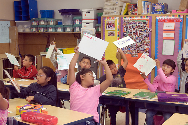 "Oakland CA 2nd graders showing correctly spelled words on dry erase boards, one girl unable to do it ""I am dum""  MR"