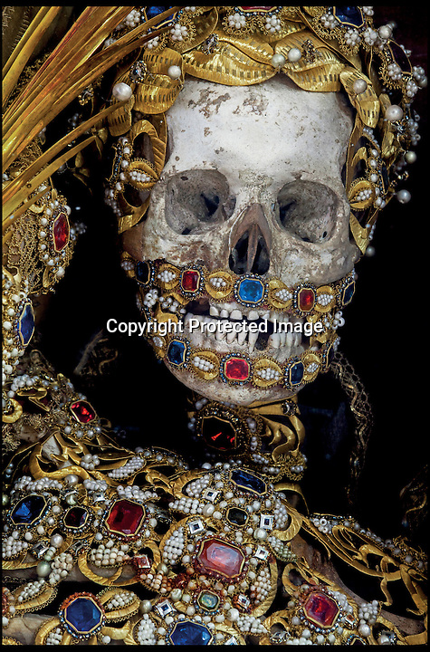 BNPS.co.uk (01202) 558833<br /> Picture: Paul Koudounaris/BNPS<br /> <br /> ***Please use full byline***<br /> <br /> Dripping with gold and jewels - lid finally lifted on the incredible remains of the Catholic saints.<br /> <br /> St Albertus in the church of St George in Burgrain, Germany, .<br /> <br /> A relic hunter dubbed 'Indiana Bones' has lifted the lid on a macabre collection of 400-year-old jewel-encrusted skeletons unearthed in churches across Europe. <br /> <br /> Art historian Paul Koudounaris has hunted down and photographed dozens of gruesome skeletons in some of the world's most secretive religious establishments.<br /> <br /> Incredibly, some of the skeletons, which took up to five years to decorate, were even found hidden away in lock-ups and containers. <br /> <br /> They are now the subject of his latest book, which sheds light on the forgotten ornamented relics for the first time.
