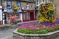 UK, England, Pateley Bridge, Yorkshire.  Village Square, Flowers, and Shops.