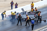 May 22, 2016; Topeka, KS, USA; Crew members run to NHRA funny car driver Tim Wilkerson after crashing during the Kansas Nationals at Heartland Park Topeka. Wilkerson was uninjured in the accident. Mandatory Credit: Mark J. Rebilas-USA TODAY Sports