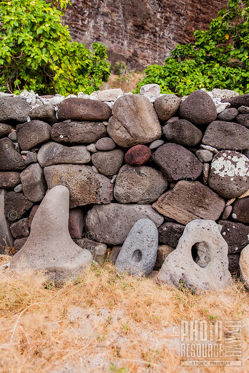 Hawaiian stone anchors along stone wall canoe shelter in Nualolo Kai village, Na Pali Coast, Kaua'i