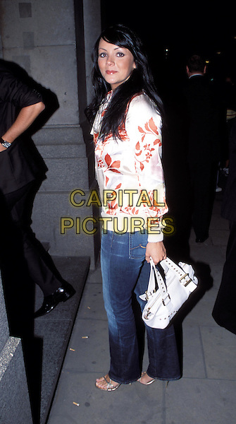 MARTINE MCCUTCHEON.Lycra British Style Awards 2003, Old Billingsgate Market.full length, full-length, denim jeans, white leather handbag, floral print satin top.www.capitalpictures.com.sales@capitalpictures.com.© Capital Pictures.