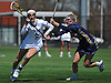 Chelsea Abreu #6 of Adelphi University, left, gets pressured by Carly McKenna #13 of Merrimack College during an NCAA Division II women's lacrosse game at Motamed Field in Garden City, NY on Saturday, April 8, 2017. Top-ranked Adelphi won by a score of 19-1.