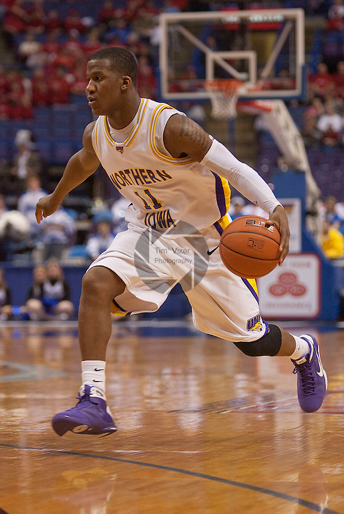 March 5,  2010              Northern Iowa guard Kwadzo Ahelegbe (11) brings the ball downcourt in the second half.   The University of Northern Iowa Panthers played the Drake University Bulldogs in Game 3 of the Missouri Valley Conference Tournament at the Scottrade Center in downtown St. Louis, MIssouri on Friday March 5, 2010.  The Bulldogs advanced to play the Panthers on the second day of competition after defeatiing the Southern Illinois University-Carbondale Salukis in Game 1.  Northern Iowa won, 55-40 and advances.
